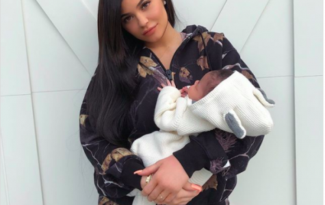Kylie Jenner Shares First Photo Of Herself Holding Her Daughter