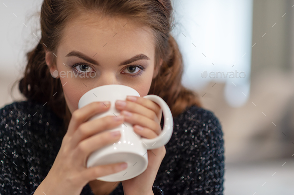 beautiful woman drinking coffee in the morning at home